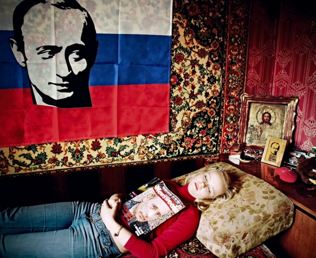 Tanya Arkhipova,  I have two t-shirts, one for the protest at the Georgian Embassy with Bush and Saakashvili's portraits and words «All of them are puppets in crafty hands», a sweatshirt saying «I want to see… for the third term», a pin, a flag, a screensaver, many different postcards with his portrait.  I like how Putin treats his children and wife, I think he's a great husband. He made people respect Russia, I can tell by my parents. Life is more stable, the pensions and allowances are rising, there's development.  ""